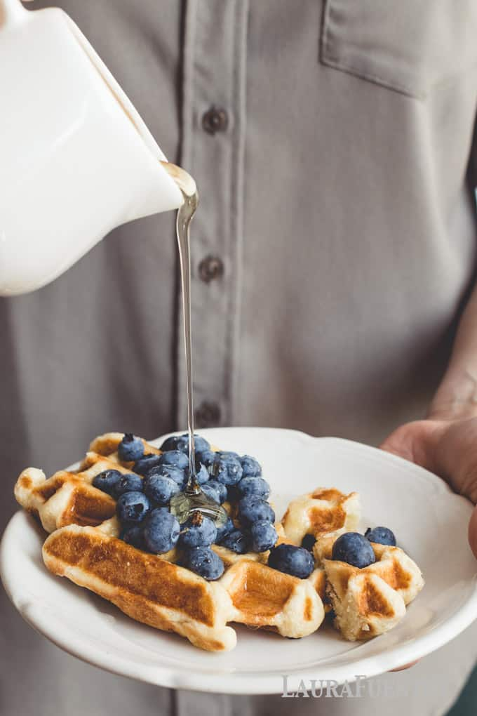Classic buttermilk waffle recipe with blueberries and maple syrup. Perfectly crispy on the outside prevents these waffles from getting soggy!