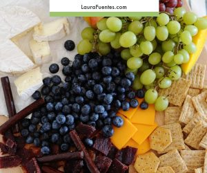 charcuterie board made simple with meat, cheese, fruit and crackers