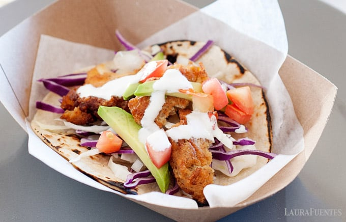 crispy fried fish tacos on a bed of slaw
