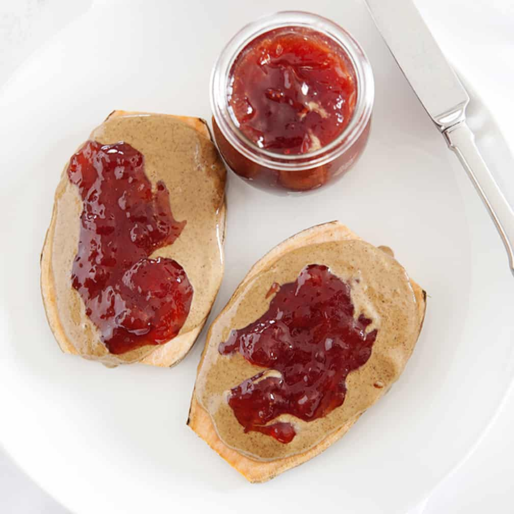 two peanut butter jelly sweet potato toasts on a plate