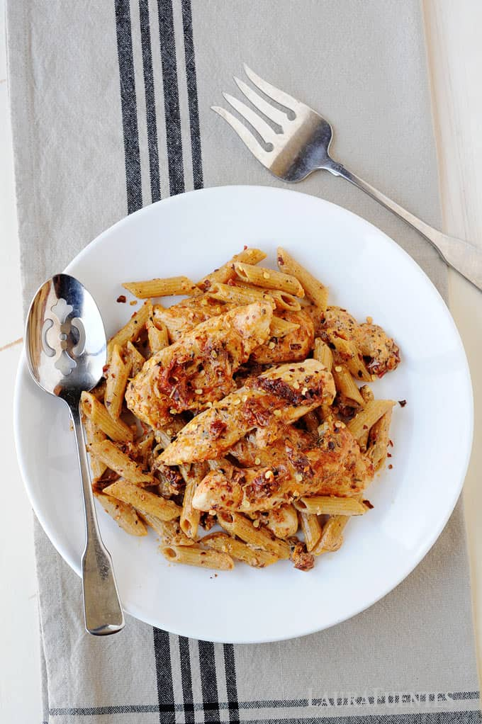 image: large plate full of sun dried tomato pasta with chicken.