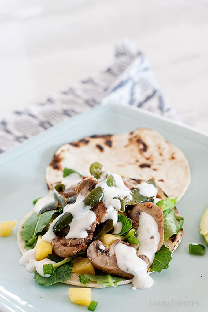 image: mushroom and veggie taco on a square blue plate
