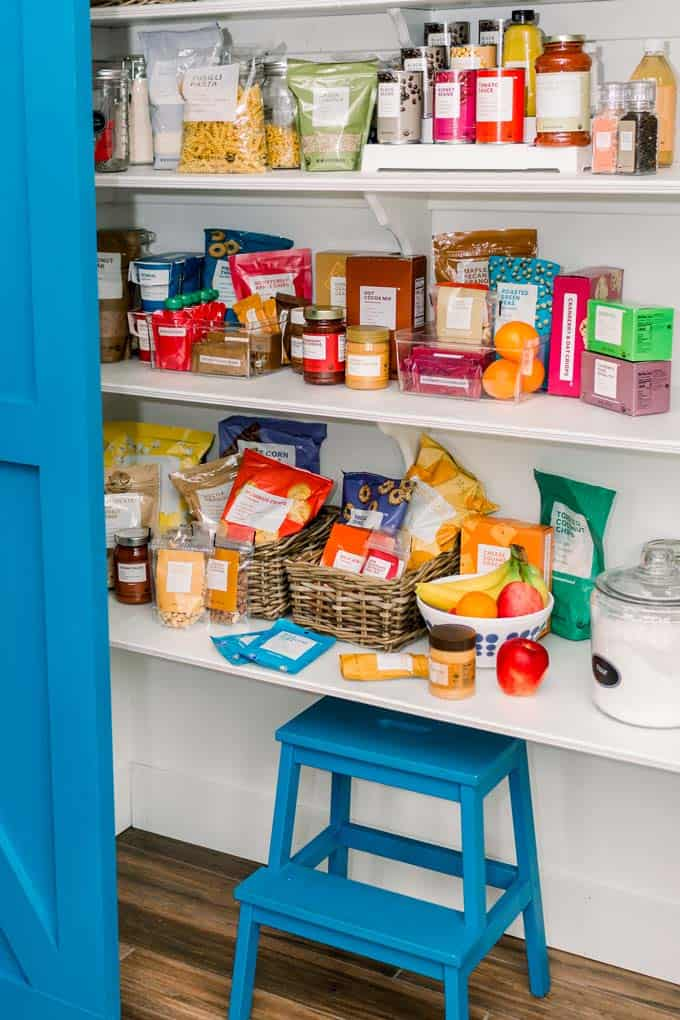 well stocked pantry with bright blue doors