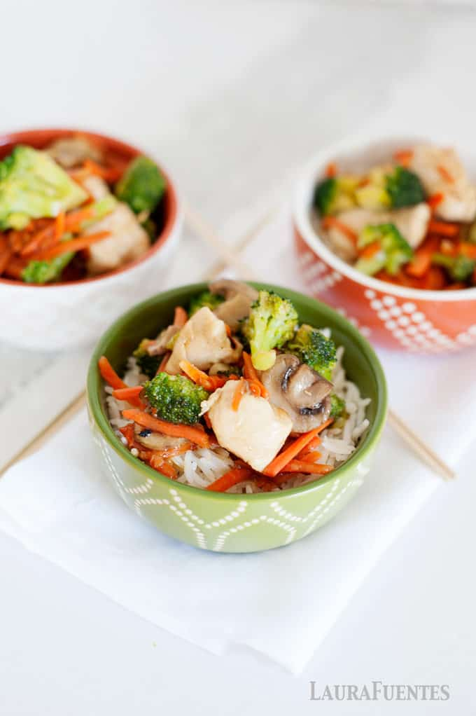 three colorful bowls filled with chicken stir fry