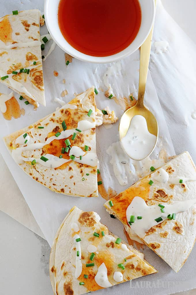 Chicken quesadilla slices with ranch dressing drizzled on top