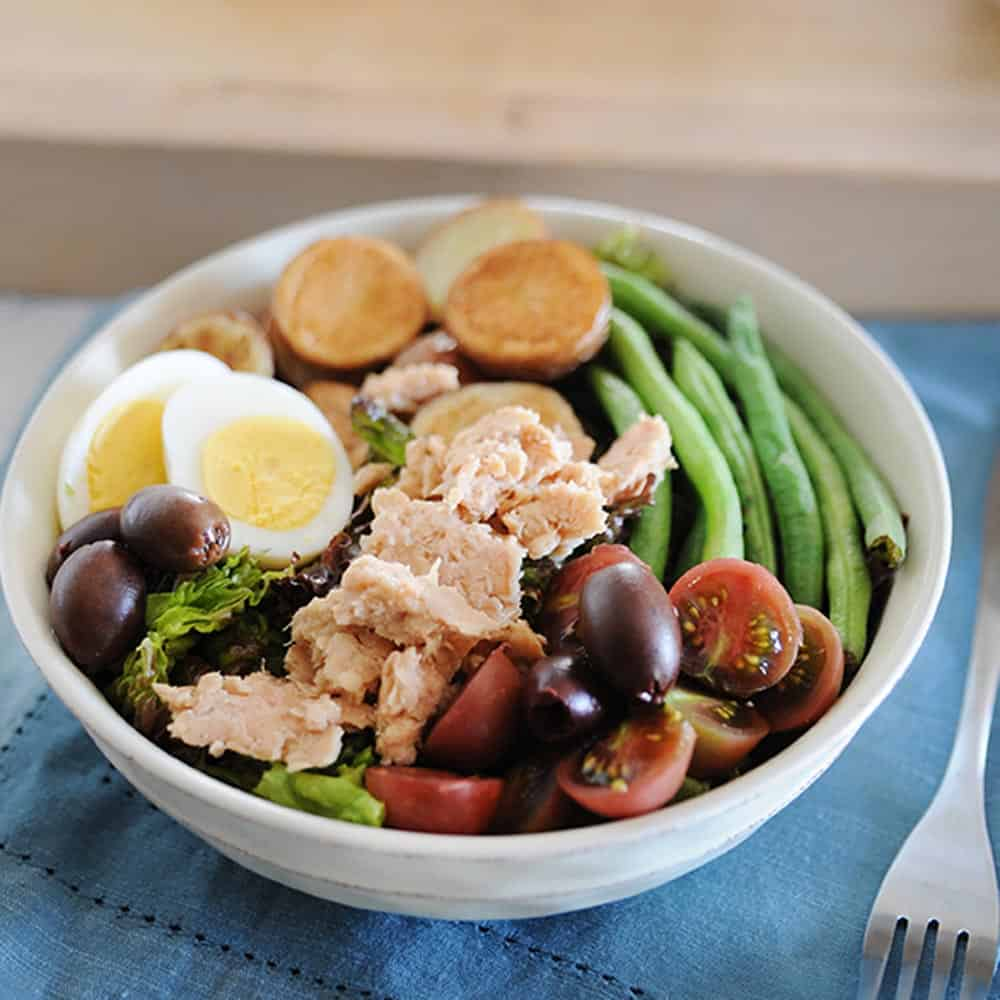salmon nicoise salad in a large bowl