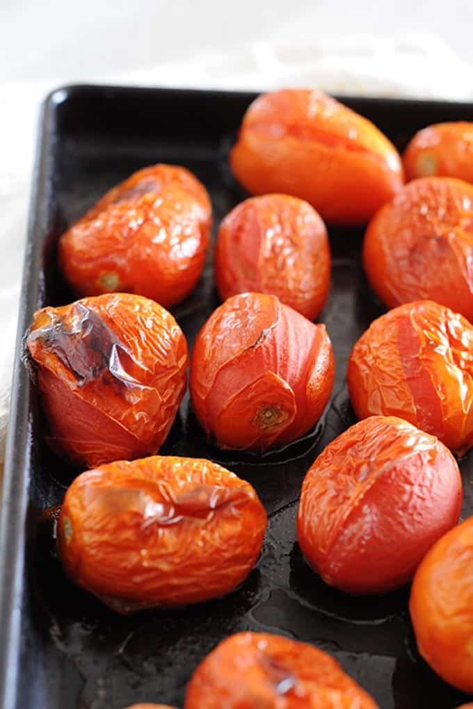 image: Roma tomatoes roasting on a pan