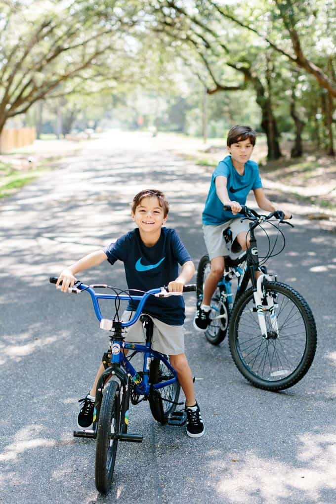 image: two boys on bikes outside