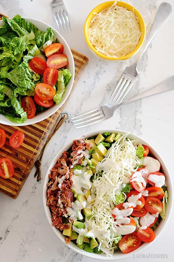 image: blt salad in a bowl with individual ingredients in other bowls to the side