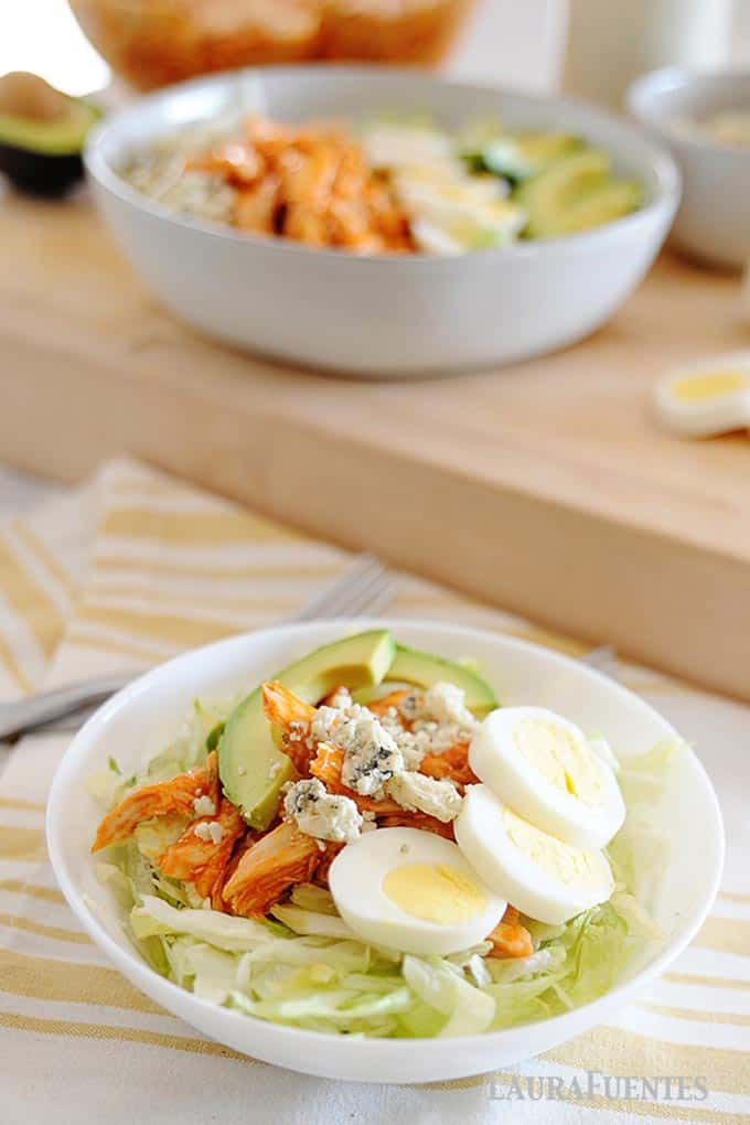 image: bowl of buffalo chicken salad with all the traditional toppings