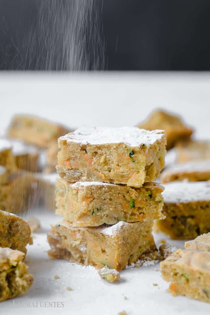 zucchini cake bars being sprinkled with sugar