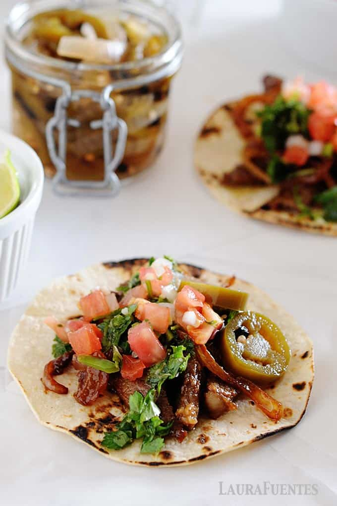 image: flat lay of steak tacos with chimichurri sauce