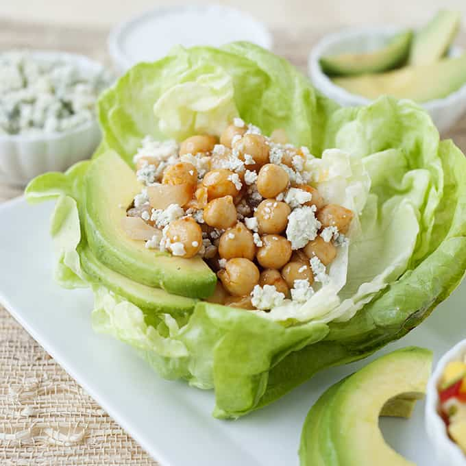 image: lettuce cups with avocado, cheese and chickpeas