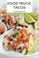 tacos on a plate with lime wedges