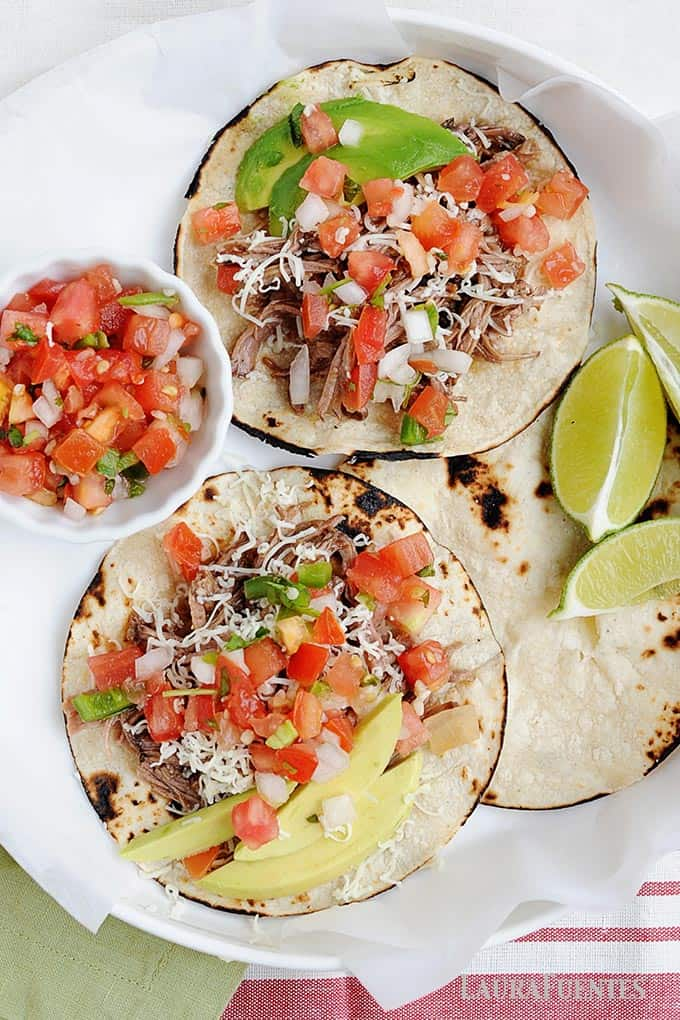 tacos on a plate with small dish of pico de gallo