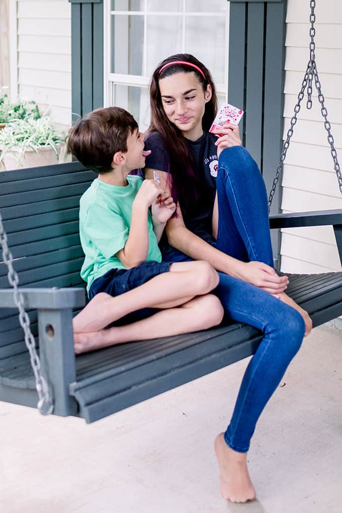 brother and sister on a swing enjoying probiotic supplements