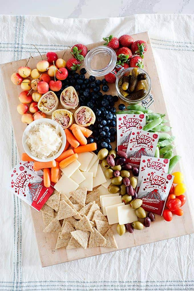 charcuterie board with lava rox, fruit, cheese, vegetables and more