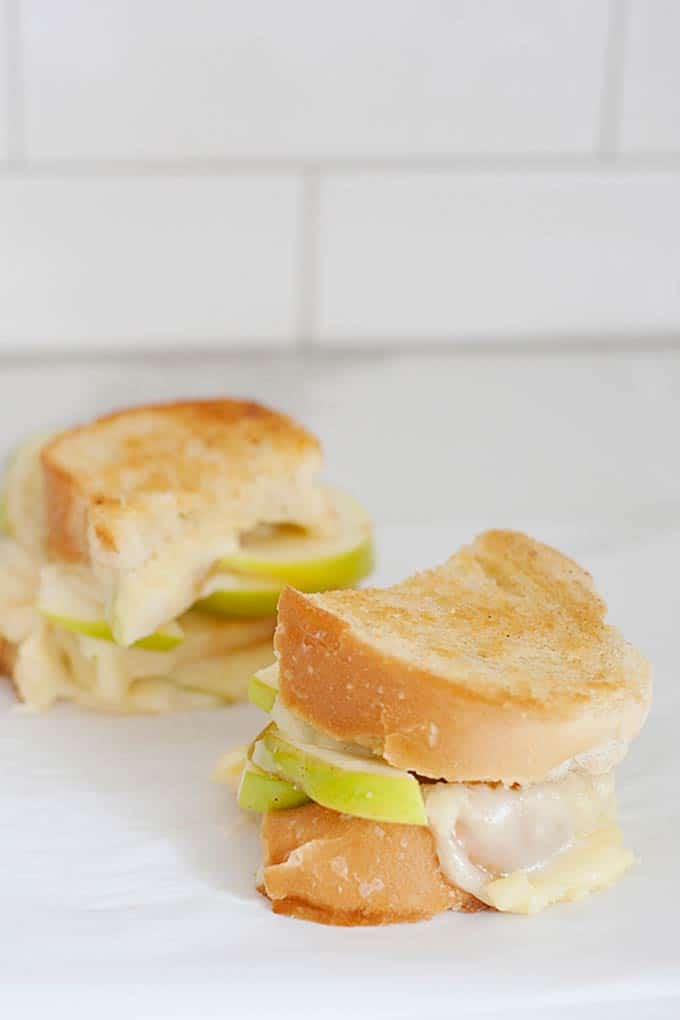 apple grilled cheese sandwich halves on white background