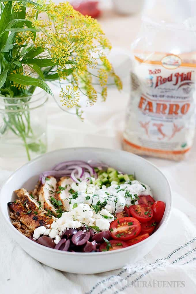 chicken farro bowl with bob's red mill bag of farro in background