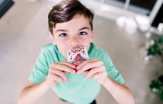 young boy eating lava rox proviotics from bag