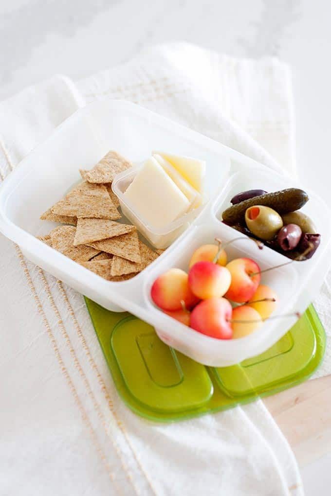 cherries, olives, crackers and cheese in a lunchbox