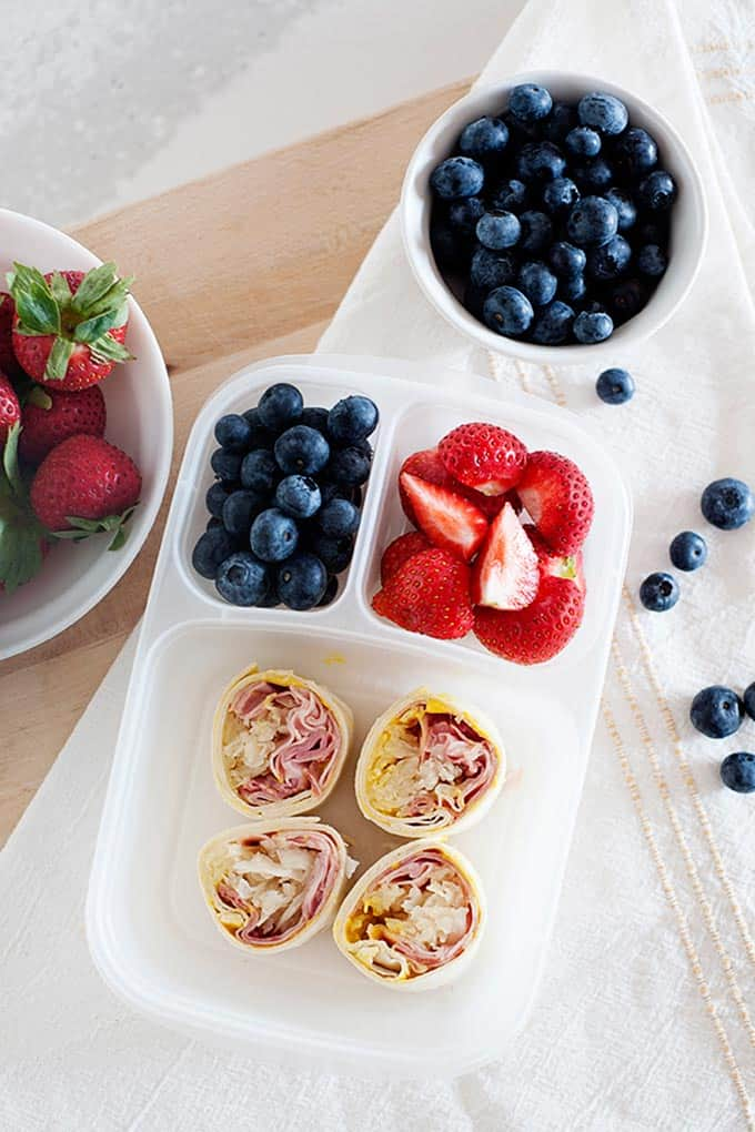 fruit and rolled lunch in a lunchbox