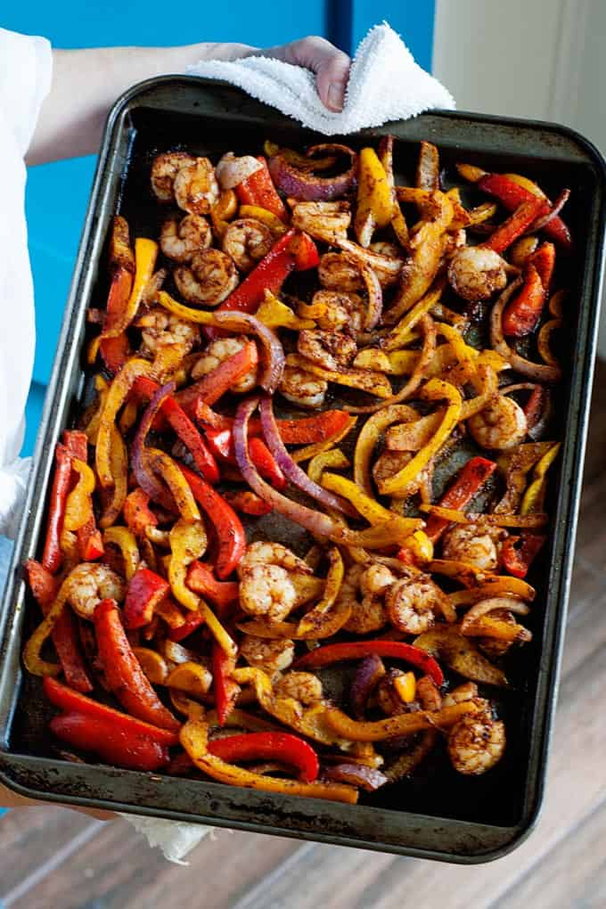 pan of sliced peppers and shrimp fresh from the oven