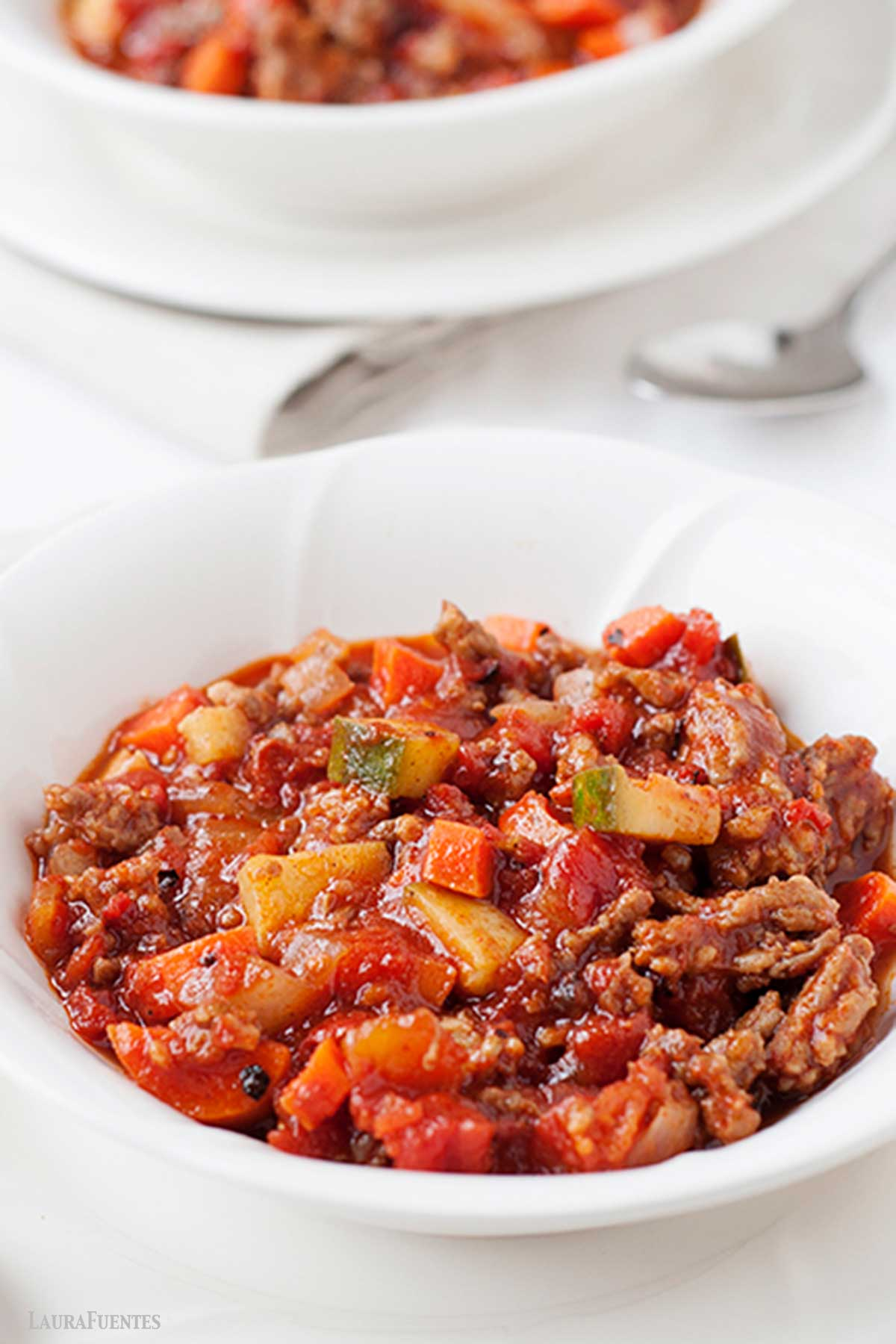ground chicken chili with vegetables in a bowl