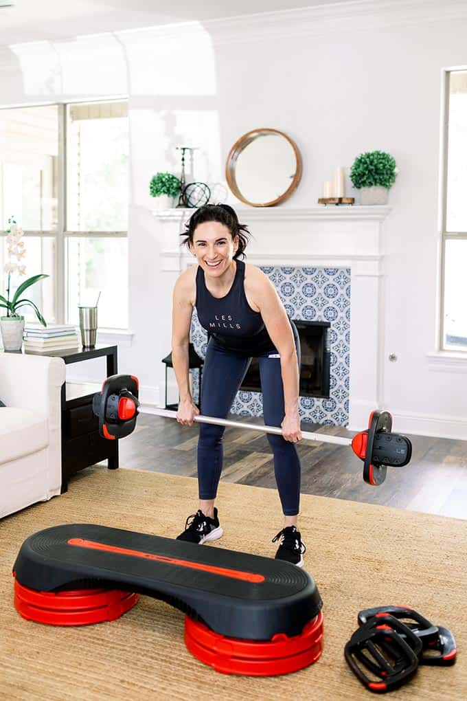 woman in living room lifting weights