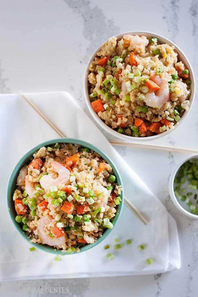 image: two bowls of fried rice with shrimp