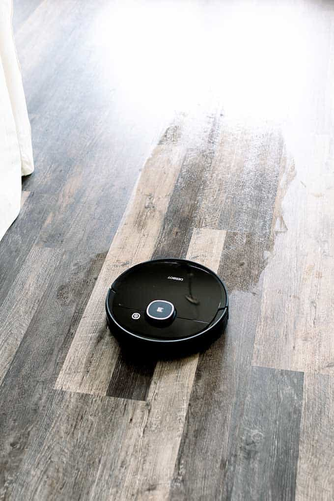 image: ecovacs vacuum on hardwood floors