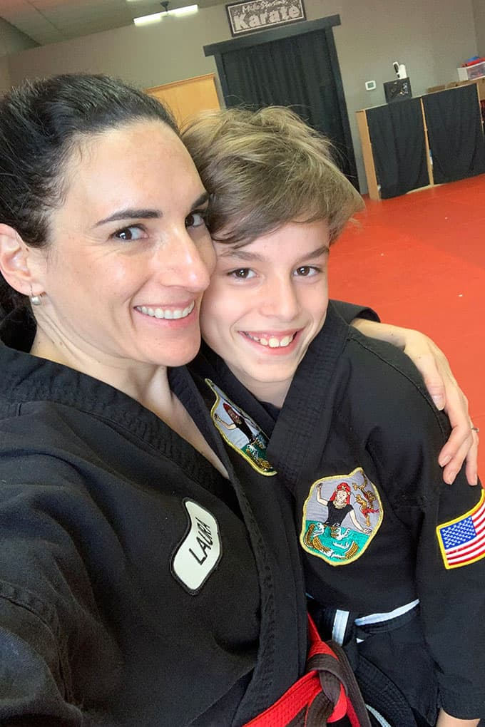 image: mother and son hugging in karate class