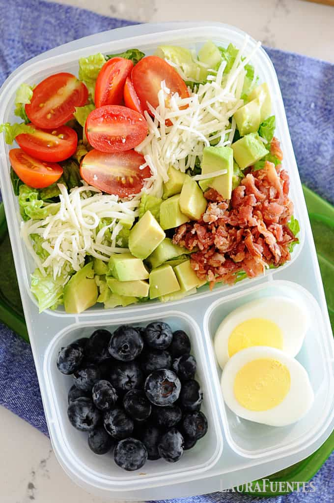 image: lunch container with BLT salad, blueberries and boiled egg slices