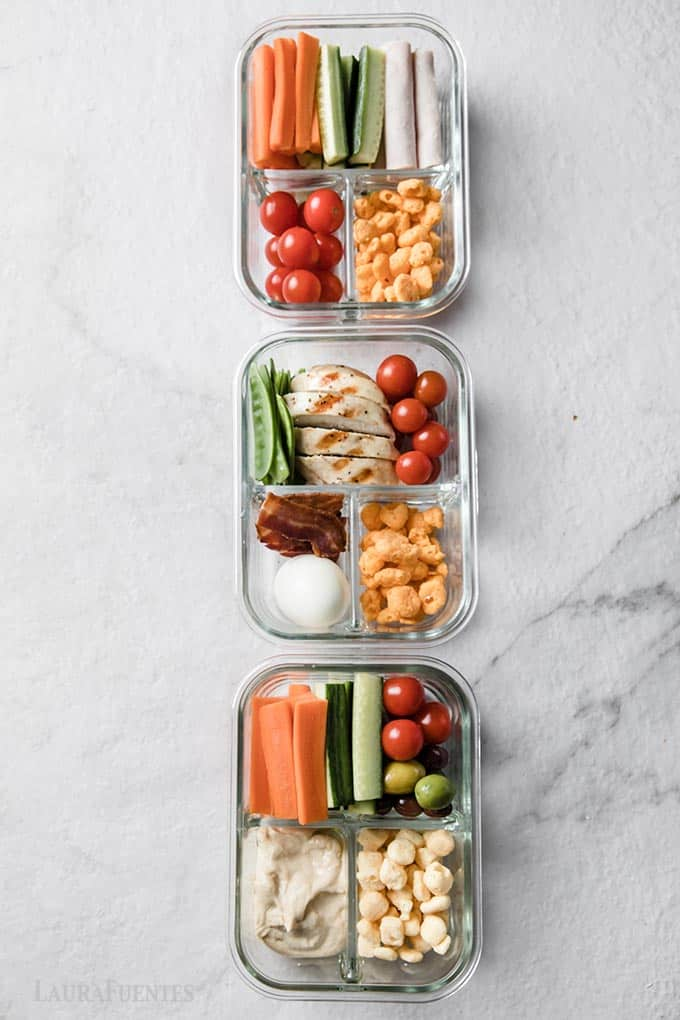 image: 3 snack boxes packed in glass containers