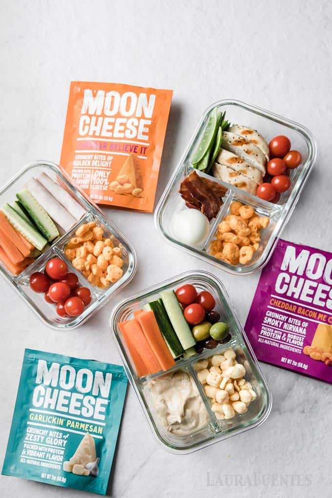 image: three full snack boxes with three bags of moon cheese