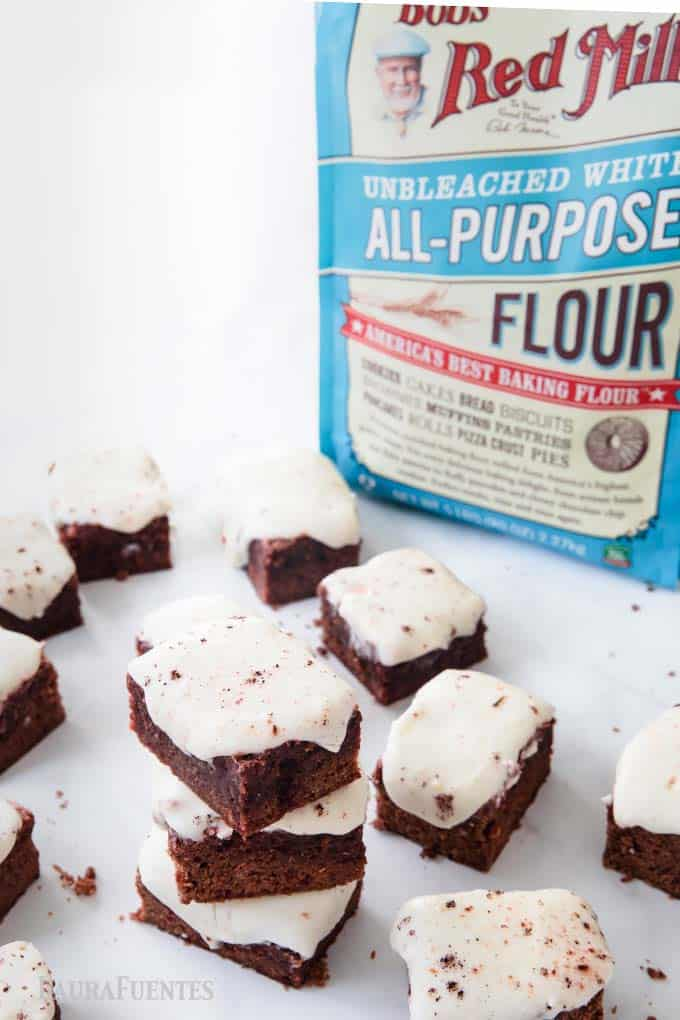 image: brownie squares with frosting and bag of flour