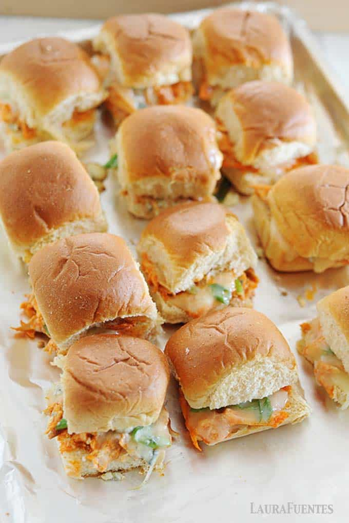 image: Freshly baked Buffalo Chicken Sliders with melted cheese, arranged on a baking sheet.