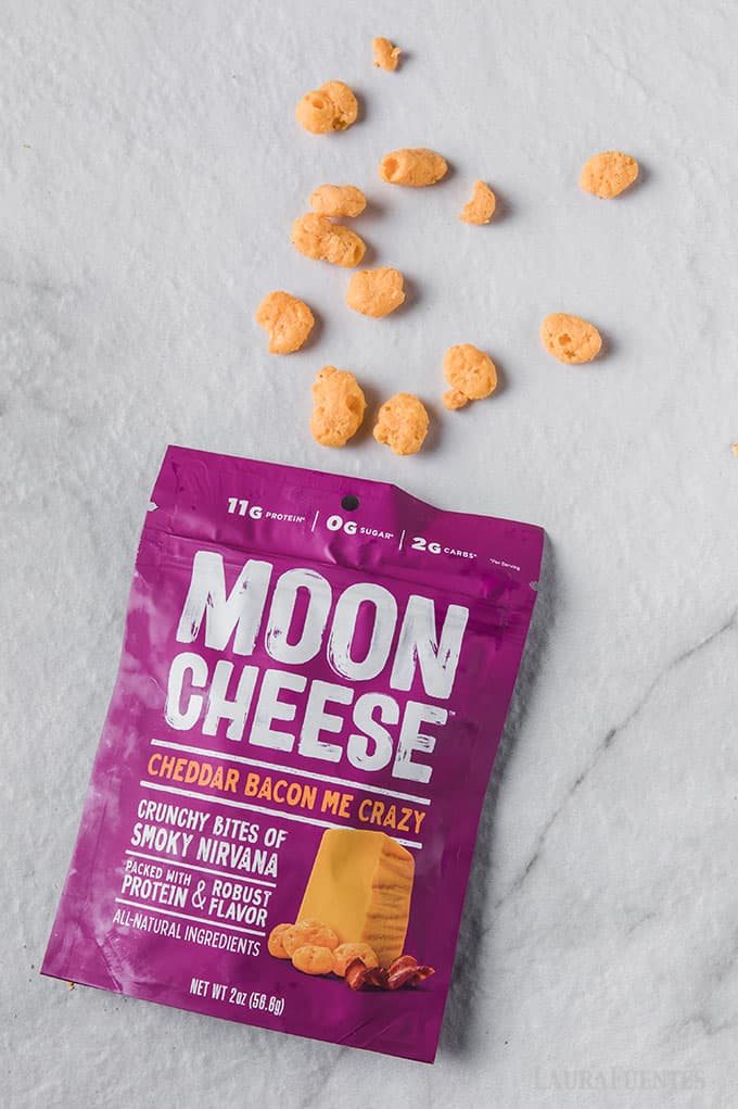 image: purple bag of moon cheese snacks spilling out onto white counter