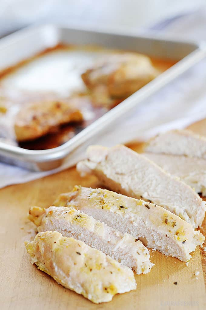 image: cook chicken breasts being sliced on a cutting board