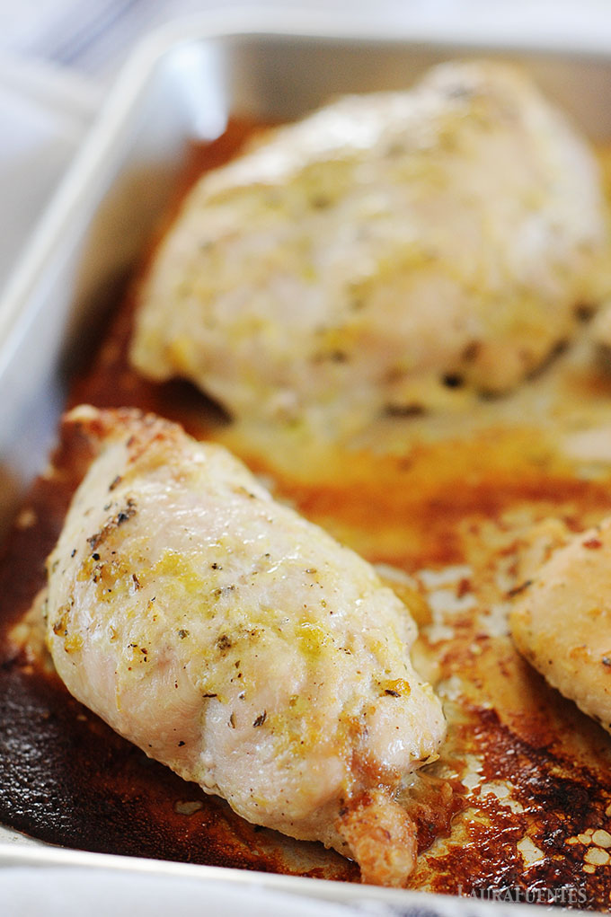 image: cooked chicken breasts on a baking sheet