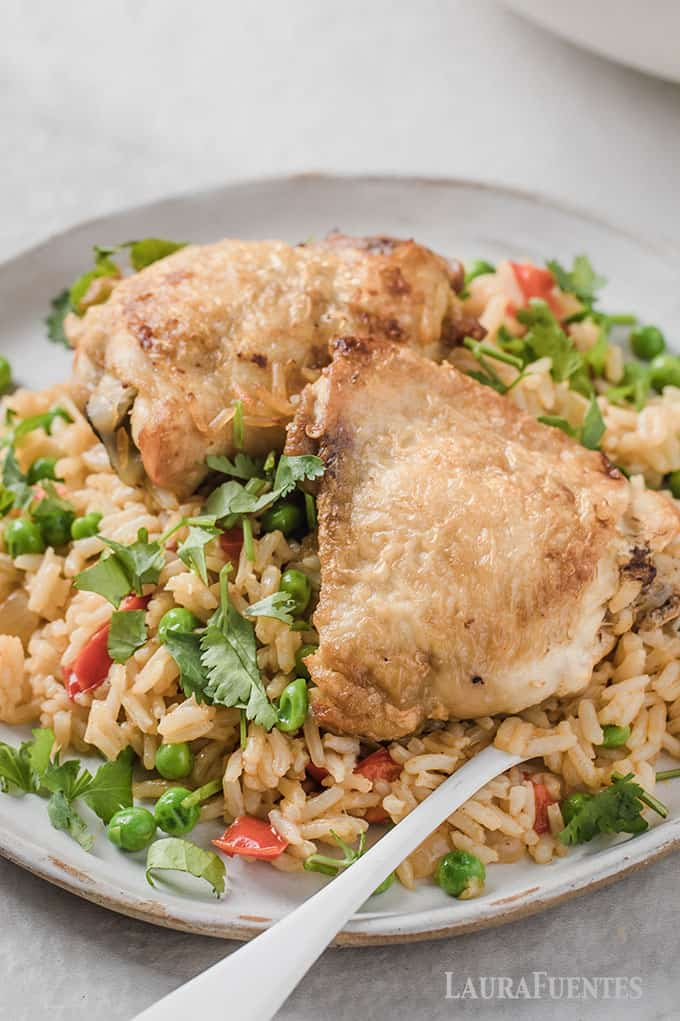 image: Plate topped with rice, vegetables and Spanish Chicken