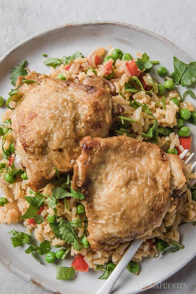 image: Closeup of plate topped with rice, vegetables and Spanish Chicken