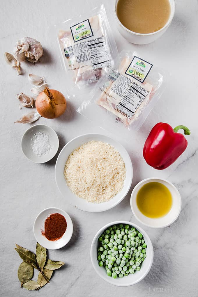 image: ingredients for Spanish Chicken laid out on a white countertop