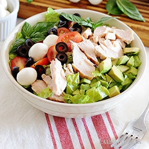 chicken and vegetables on a bed of lettuce