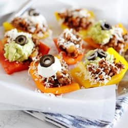 Image: bell pepper nachos topped with cheese and sour cream