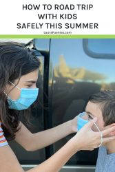 Image: Woman putting a surgical mask on a child