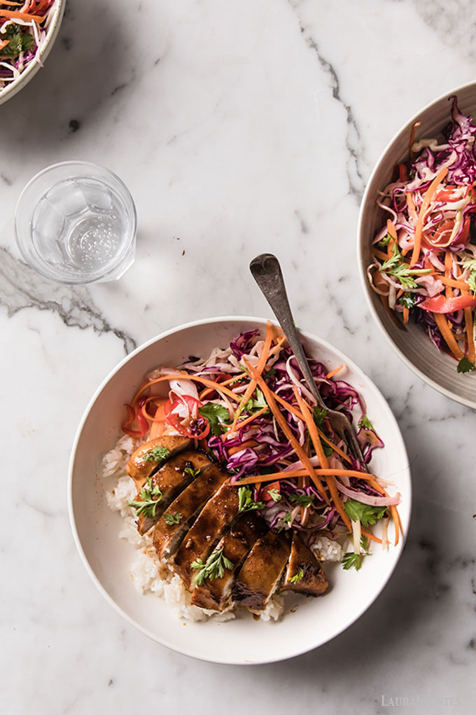 Image: Sliced chicken breast on bed of rice with Korean Slaw on the side.