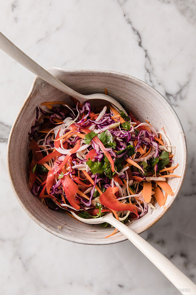 image: bowl of Korean slaw mixed with sauce