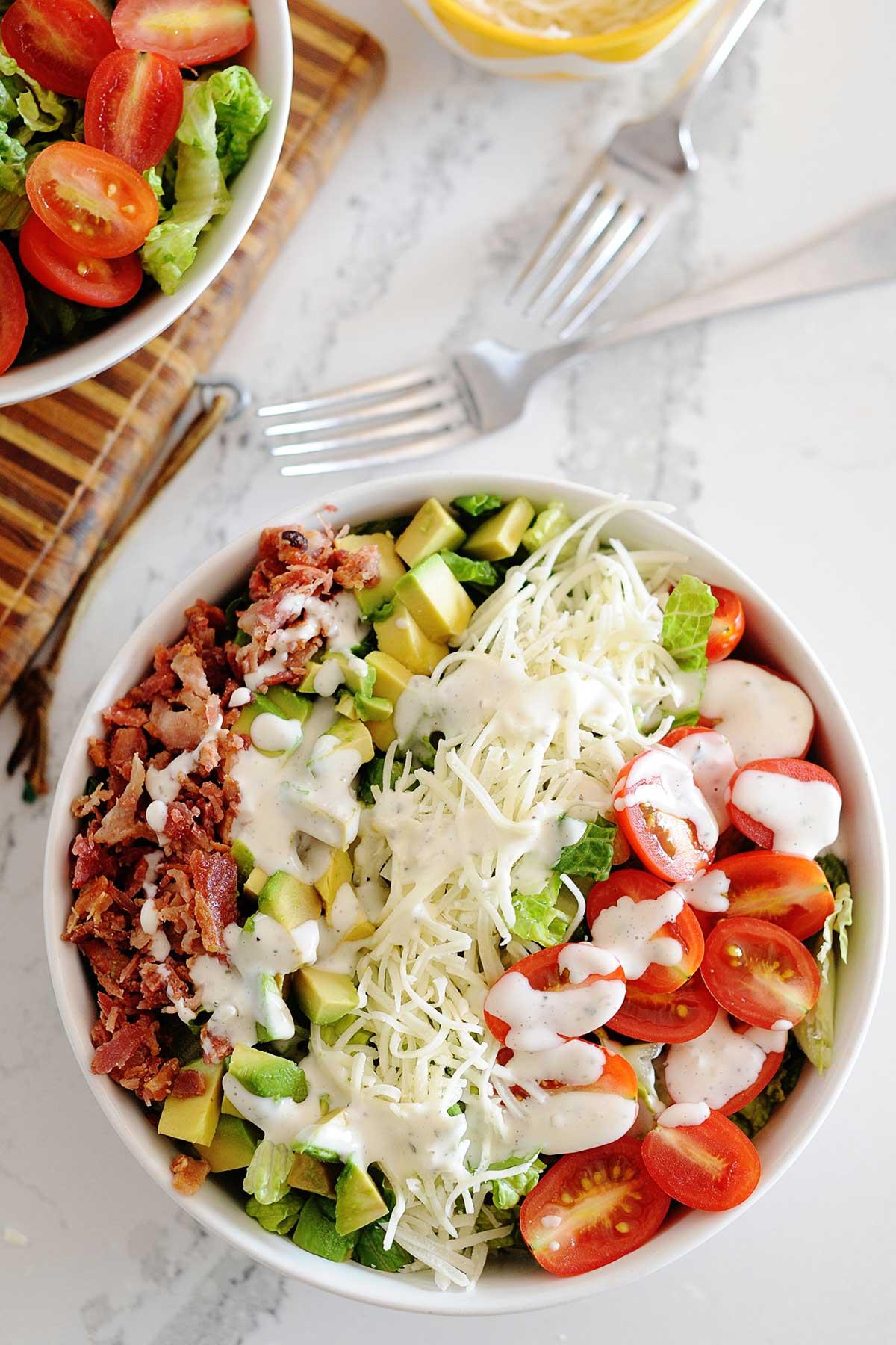 huge blt salad with dressing in a bowl