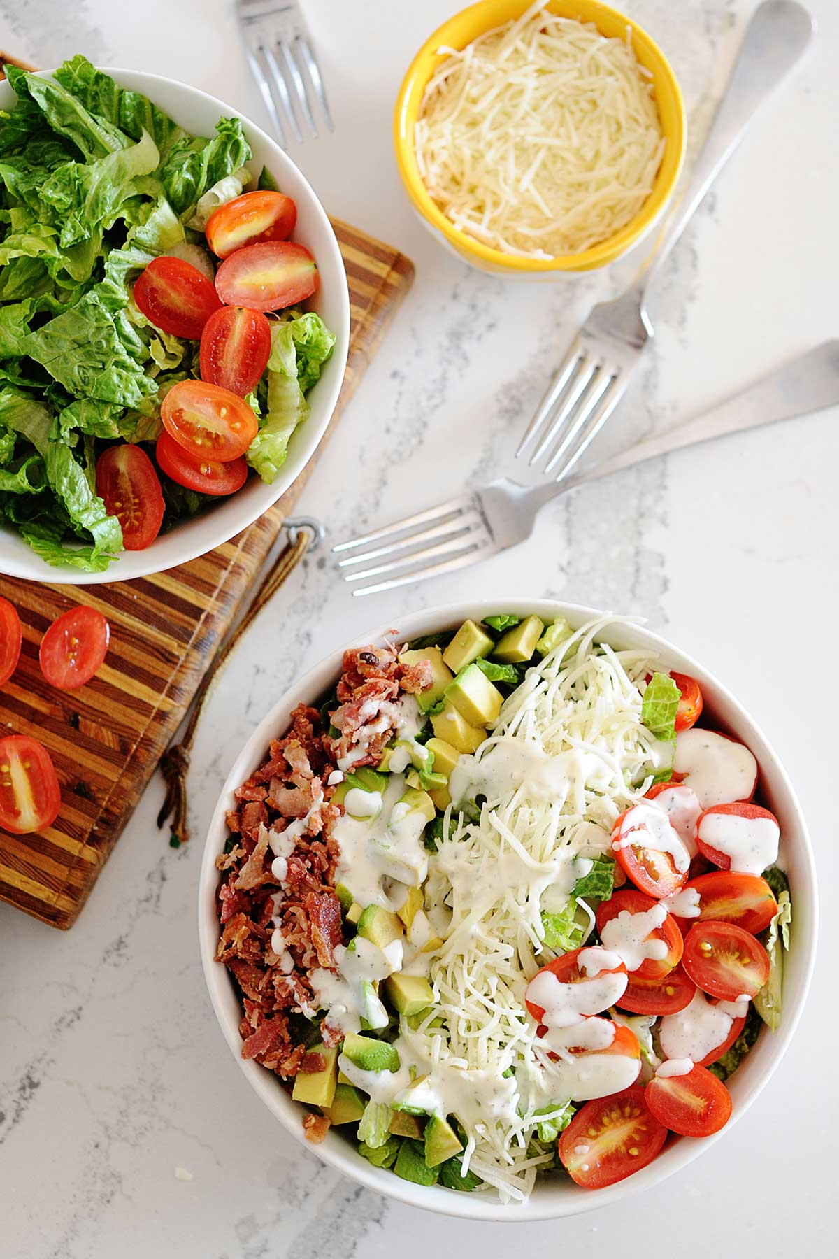blt salad in a bowl with individual ingredients in other bowls to the side